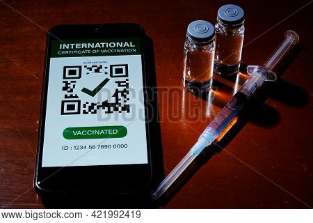 A Picture In Dark Mode Of Smartphone With Fake International Certificate Of Vaccination On It, Two D