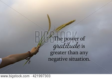 Inspirational Quote - The Power Of Gratitude Is Greater Than Any Negative Situation. Hand Holding Bu