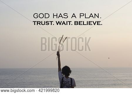 Spiritual Inspirational Quote - God Has A Plan. Trust Wait And Believe. On Soft Pink Sunset Light Ba