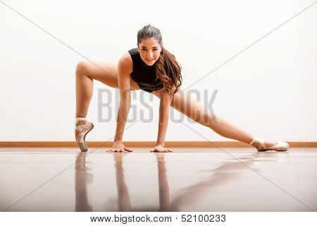 Cute ballet dancer in a studio