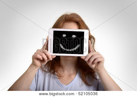 Pretty Red-haired Woman Holding Mini Tablet Pc With Smiley
