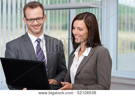 Business Man And Woman Using A Laptop