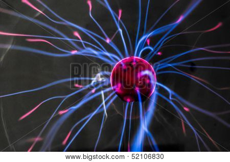 Plasma ball  with magenta-blue flames isolated on a black background.
