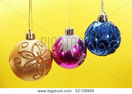 Three Colored Christmas Balls.