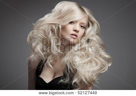 Beautiful Blond Woman. Curly Long Hair