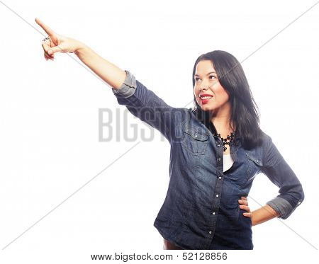 beautiful young woman showing forward to copyspace, visual imaginary or something, or pressing virual button