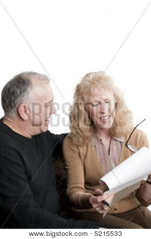 Older couple going over accounts for retirement isolated on white poster