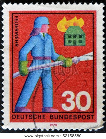 A stamp printed in the Federal Republic of Germany shows firefighter