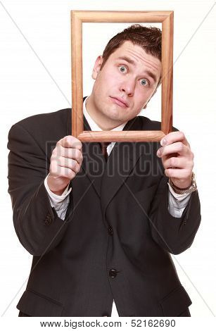 Business Man With Empty Frame Facial Expression