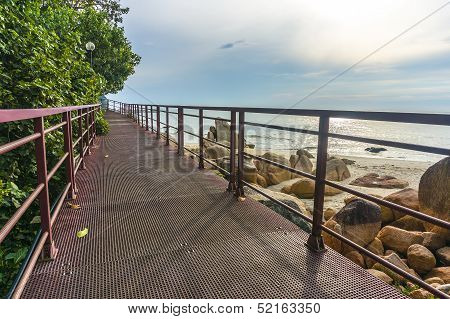 Walkway bridge to beach with cloudy scene early morning poster
