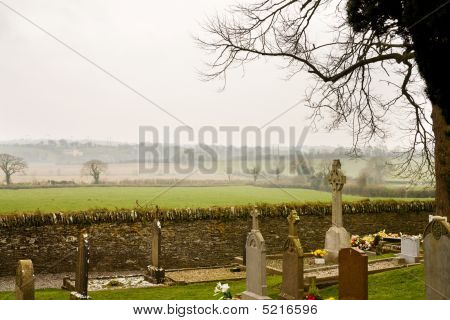 Misty Ireland At Monasterboice. View Over The Ruins.