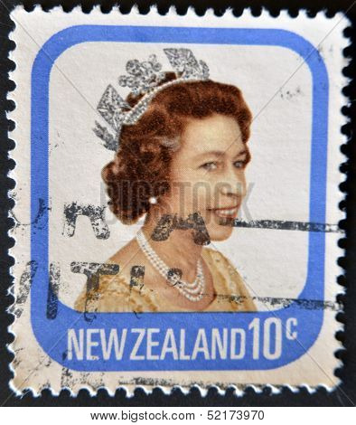 An Used First Class Postage Stamp printed in New Zealand showing Portrait of Queen Elizabeth