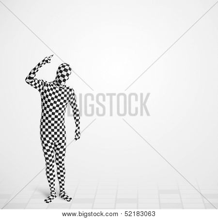 Funny guy in morphsuit body suit looking at empty copy space poster
