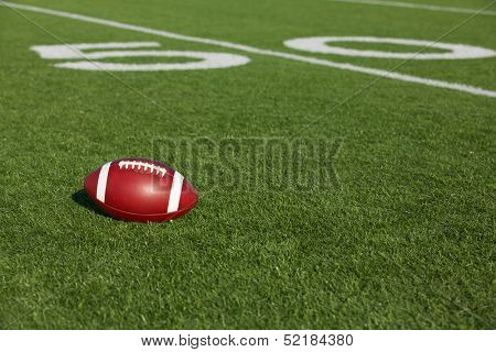 American Football on the Field near the Fifty Yard Line poster