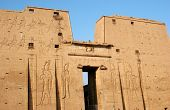 First pylon and entrance of the temple of Edfu an Egyptian temple dedicated to the chief god of Horus of the Sun at Edfu Egypt poster