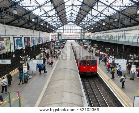 LONDON, UK - CIRCA AUGUST 2012: Train arrives at Earls Court underground station.
