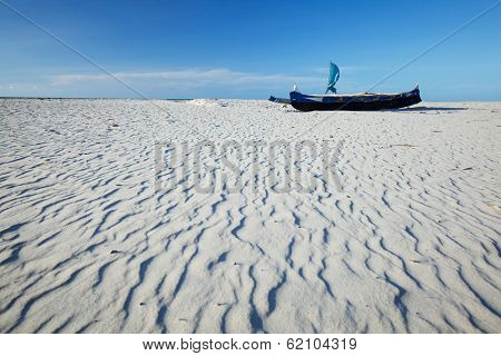Traditional Malagasy boat on a sandy beach. Morondava, Madagascar