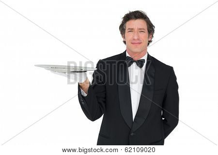 Portrait of confident waiter holding serving tray isolated over white background