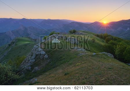 Mountain landscape with a beautiful sunset. Camping in the outdoors with a tent. The peninsula of Crimea, Ukraine, Europe