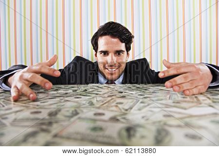 Businessman at his office with lots of money