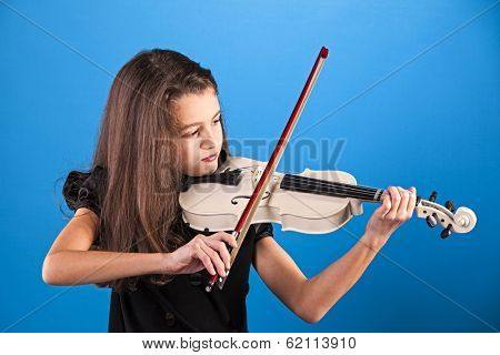 Female child playing the violin with blue background