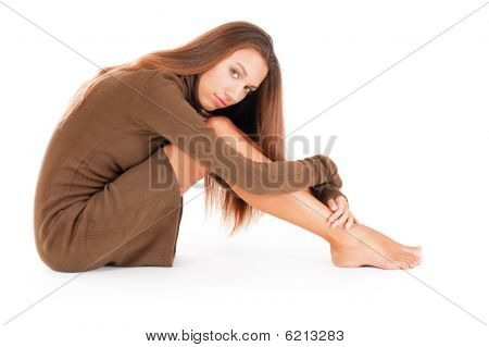 Thoughtful Woman Embracing Her Legs
