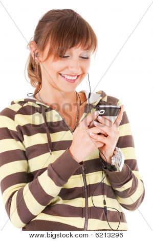 Smiling Teenager With The Cell Phone