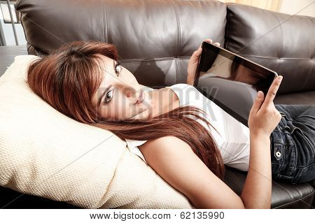 Using A Tablet Pc On The Sofa..