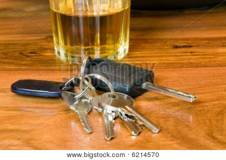 image of keys and alcohol a drink driving concept image ** Note: Shallow depth of field poster