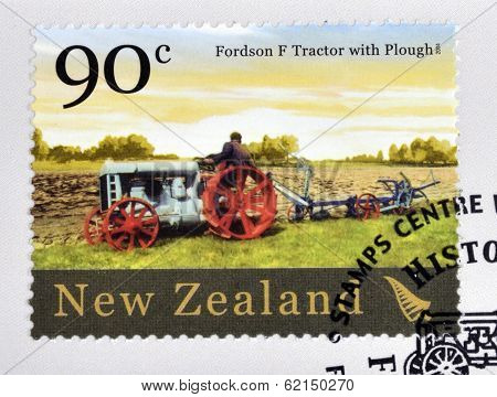 stamp printed in New Zealand dedicated to historic farm equipment shows Fordson F tractor with Ploug