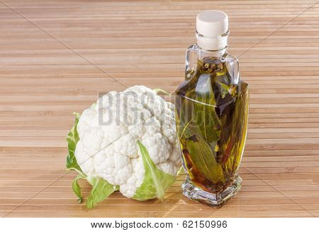 Cauliflower And Bottle Of Olive Oil With Spice