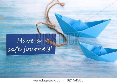 Blue Label with Have a Safe Journey and Origami Boats in the Background poster