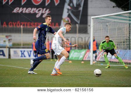 KAPOSVAR, HUNGARY - MARCH 16: Unidentified players in action at a Hungarian Championship soccer game - Kaposvar (white) vs Puskas Akademia (blue) on March 16, 2014 in Kaposvar, Hungary.