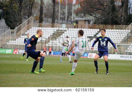 KAPOSVAR, HUNGARY - MARCH 16: Firtulescu Dragos Petrut (white 10) in action at a Hungarian Championship soccer game - Kaposvar (white) vs Puskas Akademia (blue) on March 16, 2014 in Kaposvar, Hungary.
