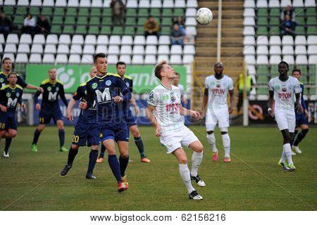KAPOSVAR, HUNGARY - MARCH 16: Kink Tarmo (white 9) in action at a Hungarian Championship soccer game - Kaposvar (white) vs Puskas Akademia (blue) on March 16, 2014 in Kaposvar, Hungary.