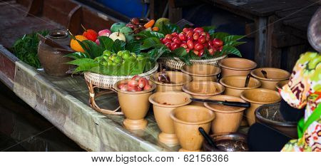 Fresh ingredients in a boat at Taling Chan floating market, Thailand poster