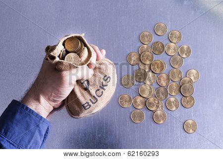 Man Holding A Money Bag Full Of Bucks