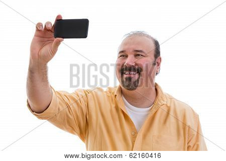 Happy Man Taking A Self Portrait On His Mobile