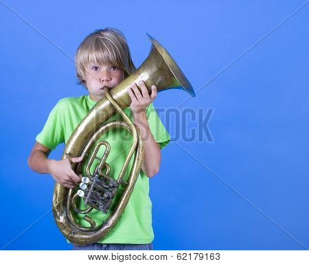 A boy plays the trumpet.