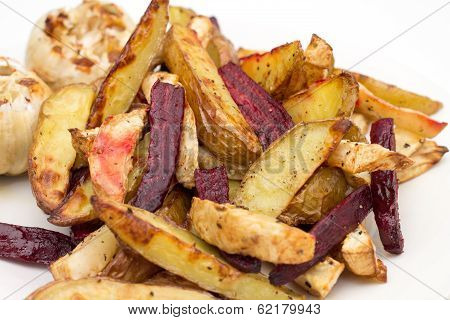 Oven Baked Potatoes, Beetroot, Celeriac And Garlic Bulbs