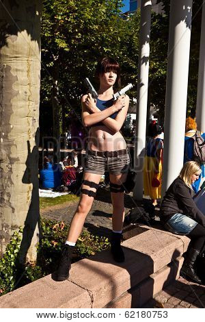 Girl Made Up As Lara Croft And Poses For Photografers