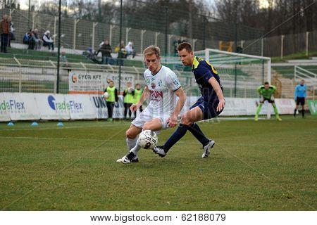 KAPOSVAR, HUNGARY - MARCH 16: Kink Tarmo (in white) in action at a Hungarian Championship soccer game - Kaposvar (white) vs Puskas Akademia (blue) on March 16, 2014 in Kaposvar, Hungary.