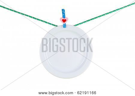 Plate dried on rope isolated on white