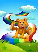 Illustration of a hilltop with a playful bear near the rainbow poster
