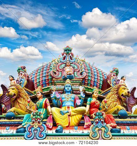 Oldest Hindu temple Sri Mariamman in Singapore over beautiful blue sky poster