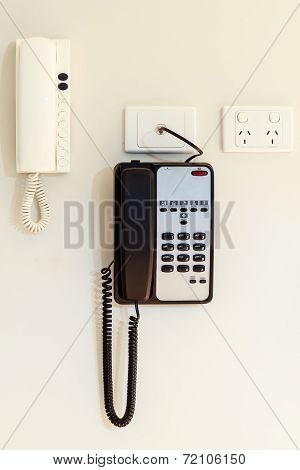 intercom home & telephone hung on a white wal poster