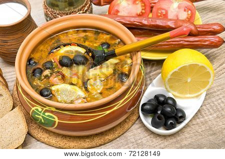 Dish Of Russian Hodgepodge Soup And Other Food.