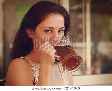Happy Woman Drinking Light Lager Beer In Pab Ang Looking