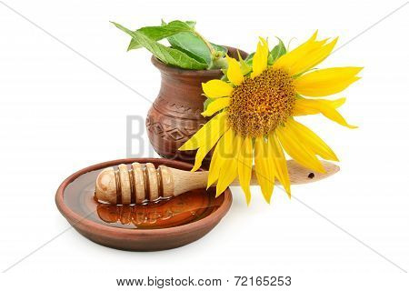clay dish with honey drizzler and flowers sunflowers poster