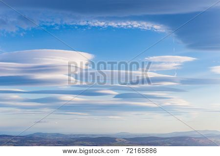 Lenticular Clouds Forming In The Troposphere
